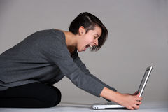 Young woman on floor with notebook Stock Photography