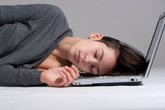 Young woman on floor with notebook Royalty Free Stock Photos