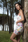 Young woman in a floral tight and short dress Royalty Free Stock Images