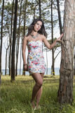 Young woman in a floral tight and short dress Stock Photo