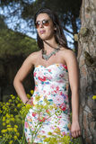 Young woman in a floral tight and short dress Royalty Free Stock Image