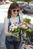 Young Woman At The Florist Shop Stock Photo