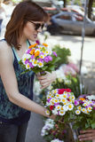 Young Woman At The Florist Shop Royalty Free Stock Photos