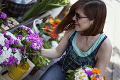 Young Woman At The Florist Shop Stock Image