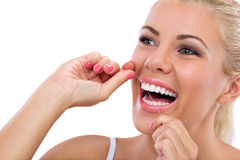 Young woman flossing her teeth Royalty Free Stock Photos