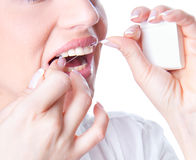 Young woman flossing teeth Stock Images