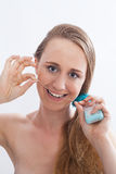 Young Woman Flossing Teeth in White Studio Stock Images