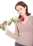 The young woman with a flower. Portrait. The young beautiful woman with a rose stock image