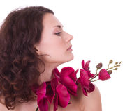 Young woman with flower Stock Images