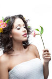 Young woman with flower. Portrait of young attractive caucasian woman with pink lily flower stock photo