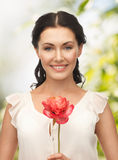 Young woman with flower Stock Photos