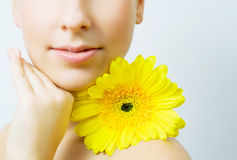 Young woman with flower. Stock Images