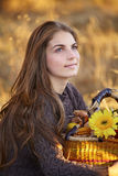 Young woman with flower basket Stock Image