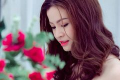 Young woman with flower bouquet Royalty Free Stock Photography