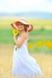 Young woman on flower field in summer Stock Photos