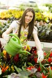 Young woman in flower garden Stock Image