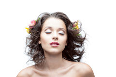 Young woman with flower in hair. Portrait of young attractive caucasian woman with lily flowers in hair Royalty Free Stock Photos