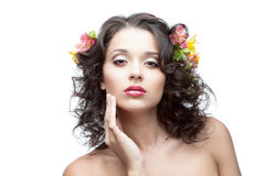 Young woman with flower in hair. Portrait of young attractive caucasian woman with lily flowers in hair stock image