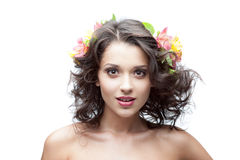 Young woman with flower in hair. Portrait of young attractive caucasian woman with lily flowers in hair royalty free stock photography