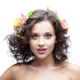 Young woman with flower in hair Royalty Free Stock Images