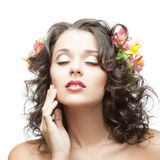 Young woman with flower in hair Royalty Free Stock Image