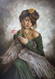 Young woman with a flower in her hair and green dress Royalty Free Stock Photos