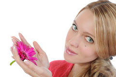 Young woman with flower in her hand Royalty Free Stock Photography