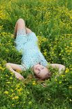 Young woman in a flower meadow Royalty Free Stock Images