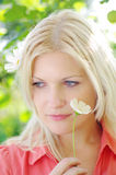 Young woman with flower outdoors Royalty Free Stock Image