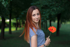 Young woman with flower portrait Royalty Free Stock Image