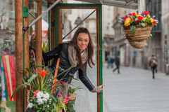 Young woman in the flower shop Royalty Free Stock Image