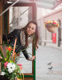 Young woman in the flower shop Royalty Free Stock Images