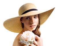 Young woman with flower in straw hat Stock Images