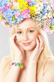 Young woman with flower wreath. Portrait of beautiful young woman with flower wreath on head Stock Image