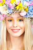 Young woman with flower wreath. Portrait of beautiful young woman with flower wreath on head Stock Images