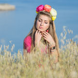 Young woman in flower wreath Royalty Free Stock Photo