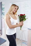 Young woman with flowers Stock Photo