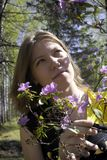 Young woman and flowers Stock Photography