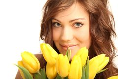 Young woman with flowers. Young brunette woman with yellow flowers royalty free stock image