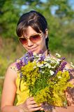Young woman with flowers Stock Image