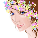 Young woman with flowers. In her hair Royalty Free Stock Photo