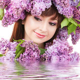 Young woman with flowers Royalty Free Stock Image