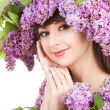 Young woman with flowers Stock Images