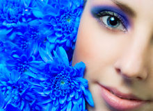 Young woman with flowers. Stock Photo