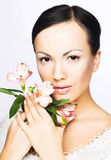 Young woman with flowers. Romantic portrait of young woman with flowers Stock Photo