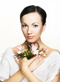 Young woman with flowers. Romantic portrait of young woman with flowers Royalty Free Stock Images