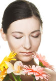 Young woman with  flowers. Portrait of young woman with several flowers Royalty Free Stock Photo