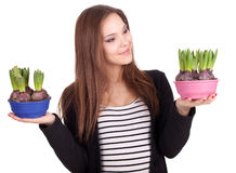 Young woman with flowers in flowerpots Stock Images