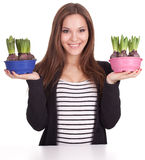 Young woman with flowers in flowerpots Stock Photography