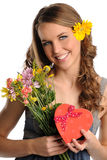 Young Woman With Flowers and Gift Box Royalty Free Stock Photos